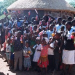 Children receiving toothbrushes.