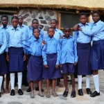School children receiving new school uniforms