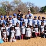 Volunteers with kids t-ball team