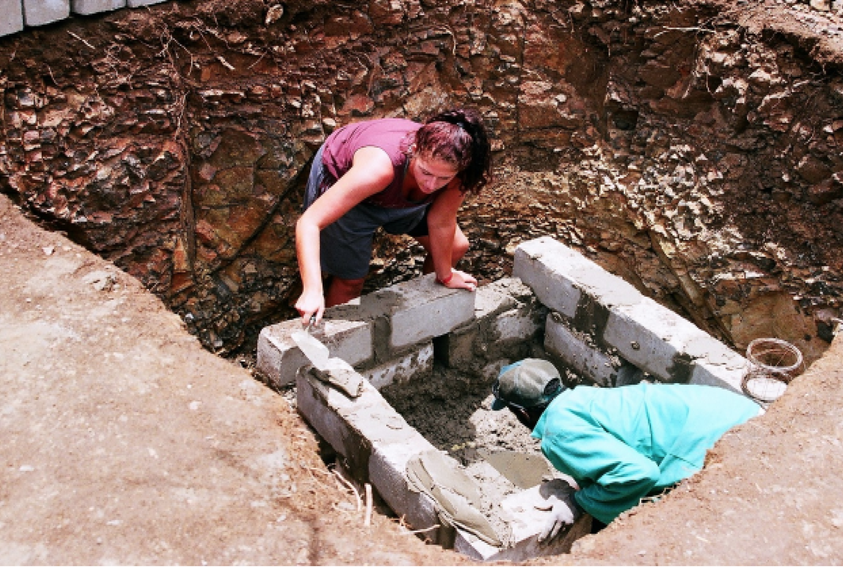 Volunteers helping to build a toilet