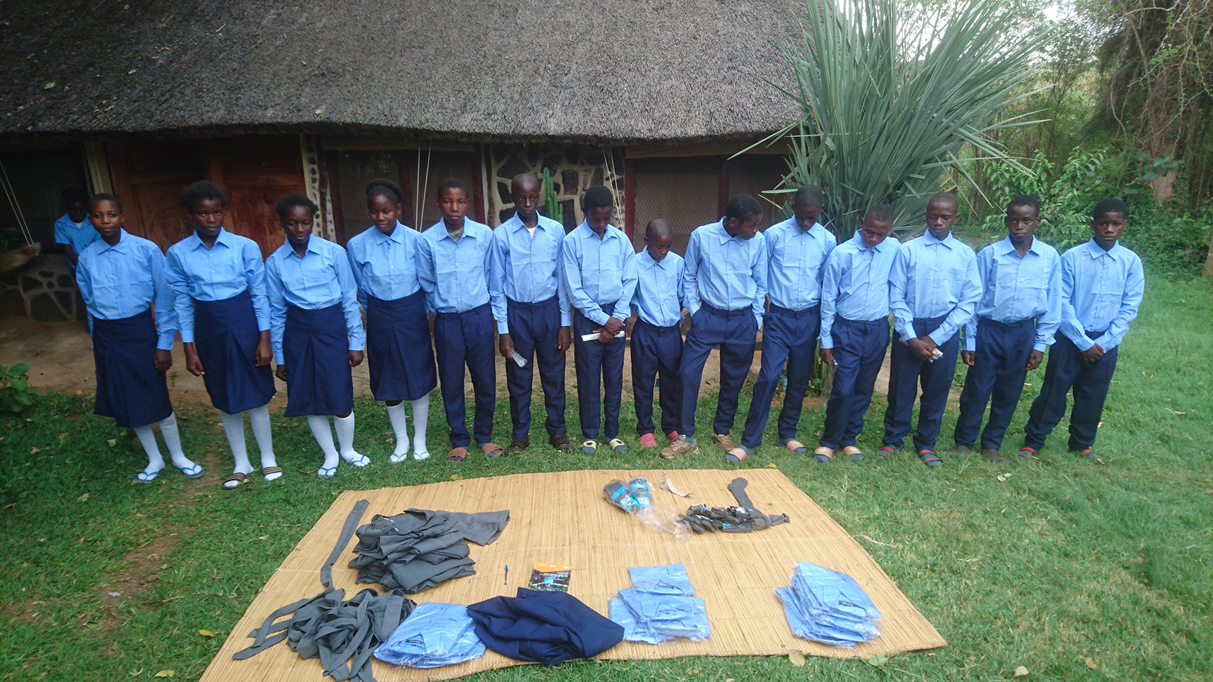 School students getting fitted with donated uniforms